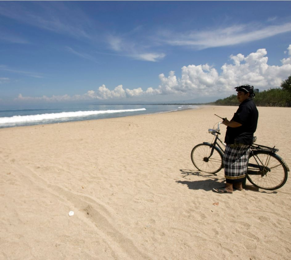 Bali Village head patrols beach