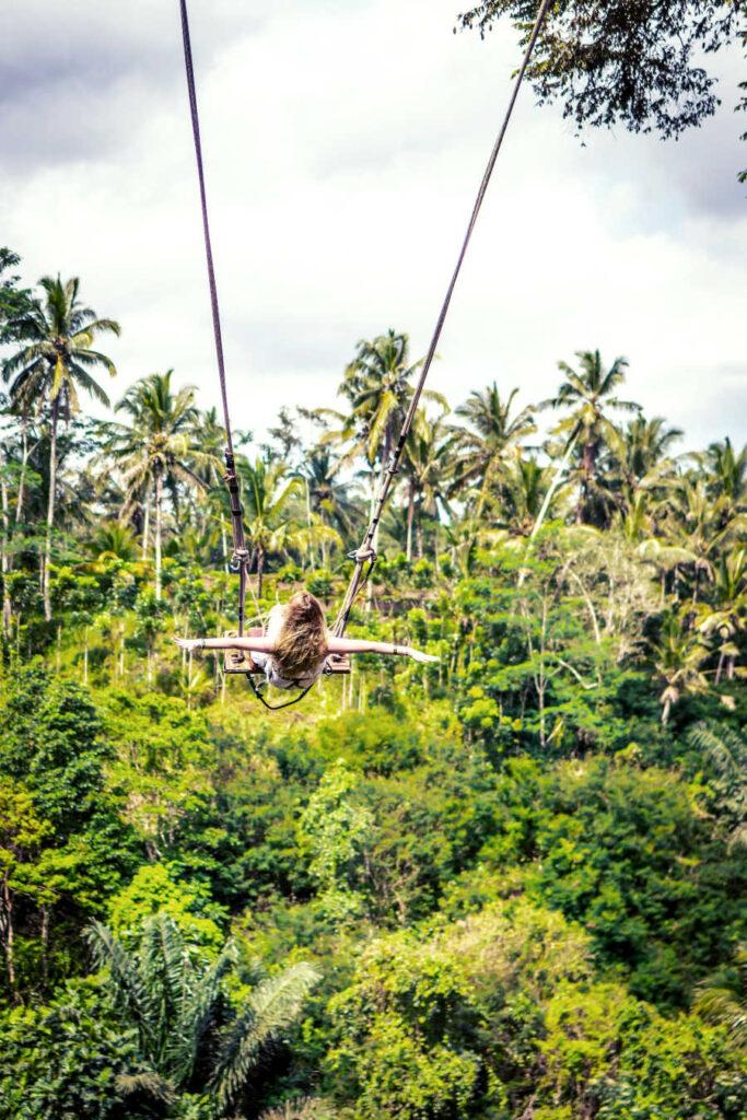 Bali tourist on swing