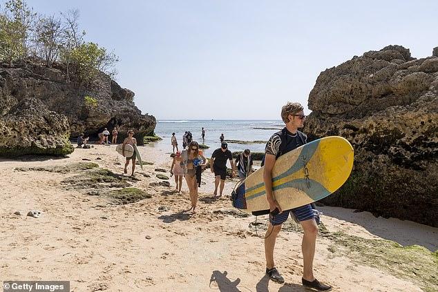 australians on beach in bali