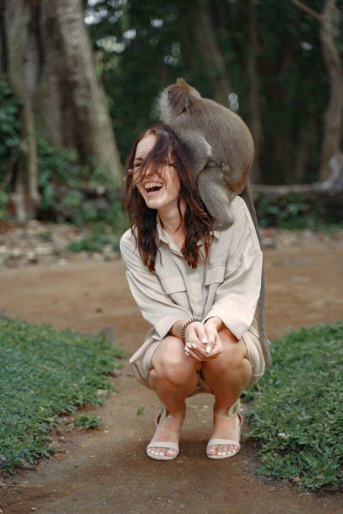 Woman tourist happy at monkey forest