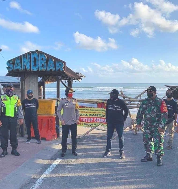 local officals at bali canggue beach