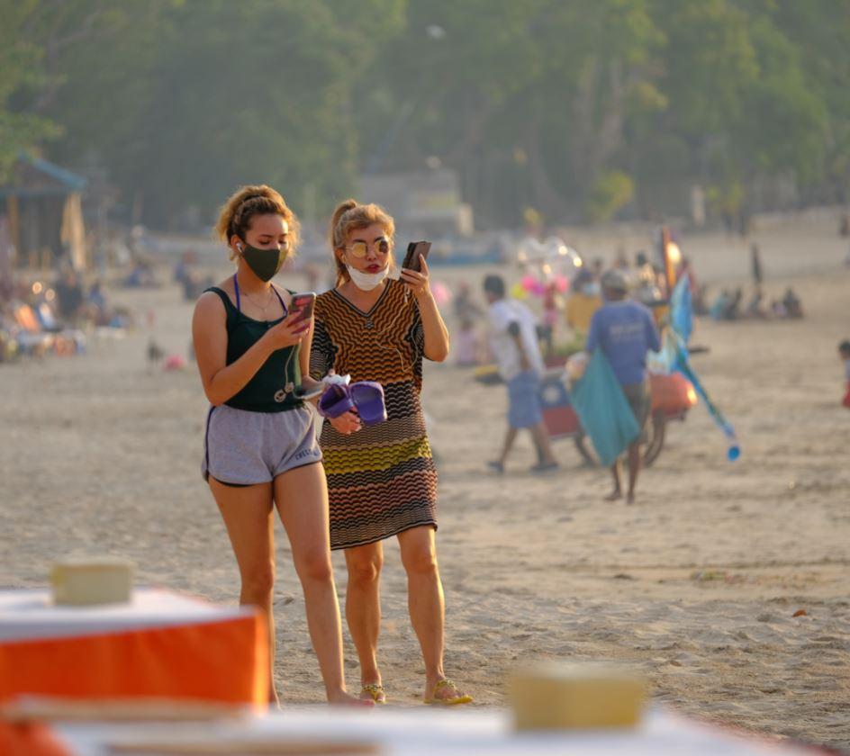 tourists on bali beach