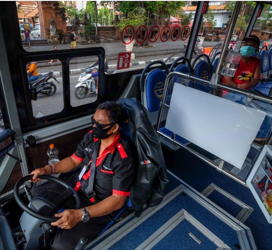 Bali locals wearing masks on bus