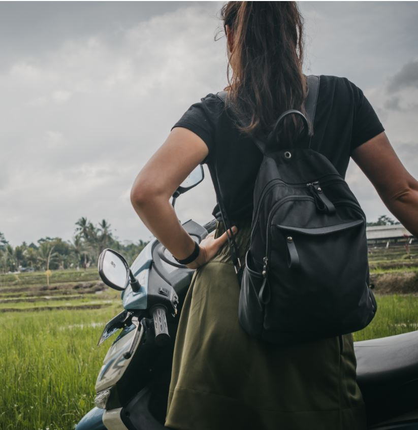woman with scooter in bali