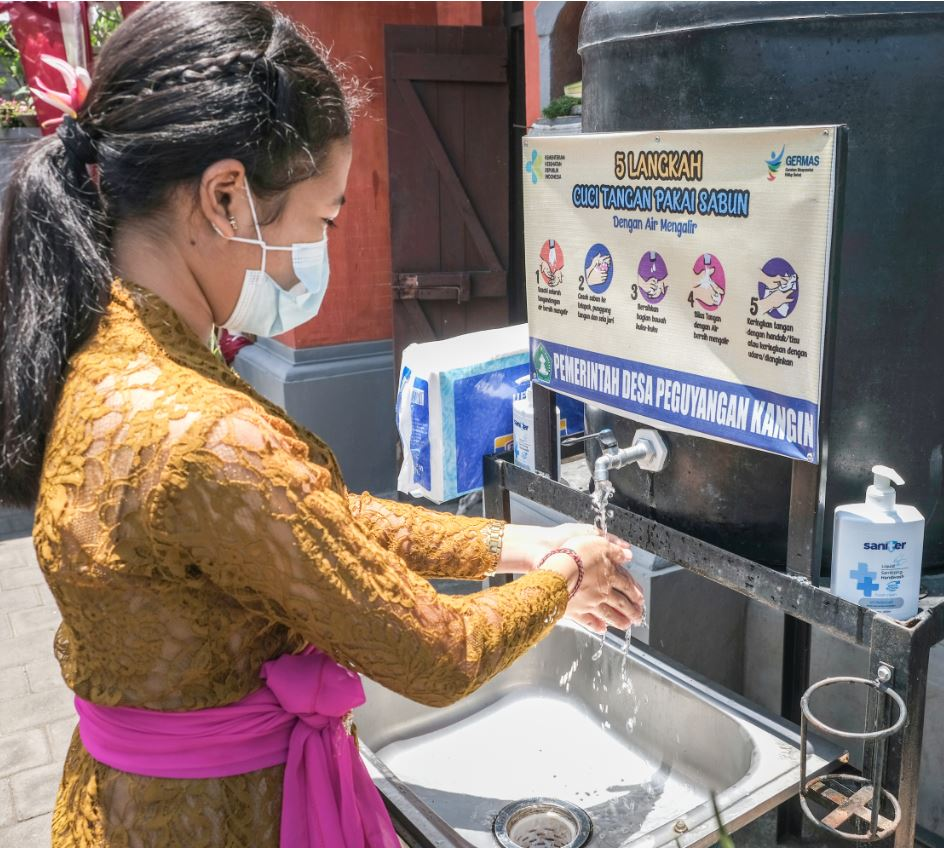 Bali resident washing hands wearing mask