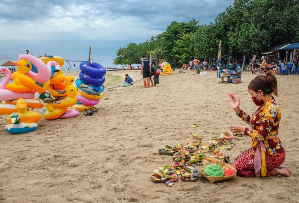 bali local prayer at beach