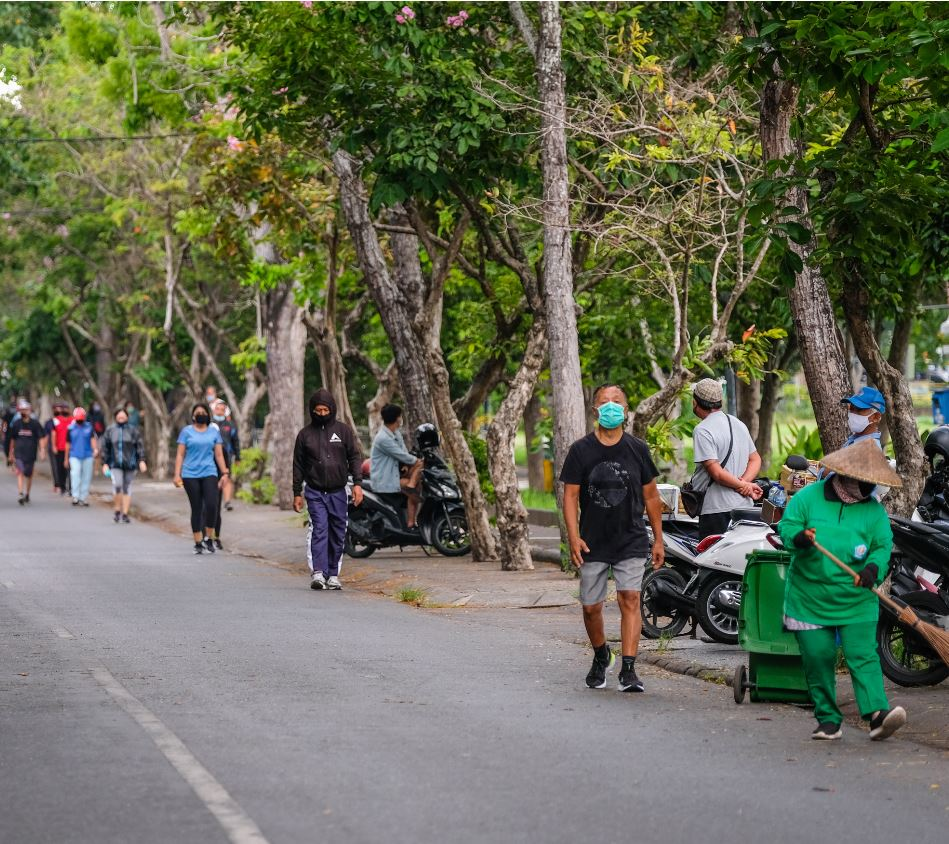 bali resident walking with masks on