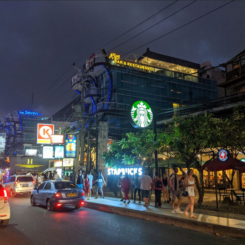 bali tourists on street starbucks