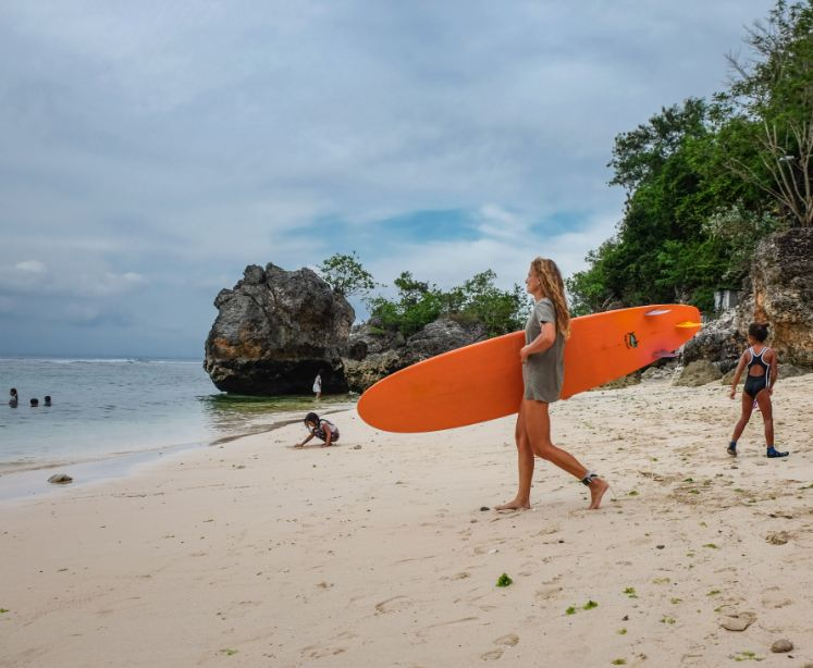Tourist surfing at Bali beach