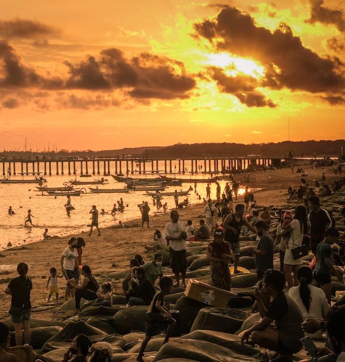 crowded beach tourists Bali