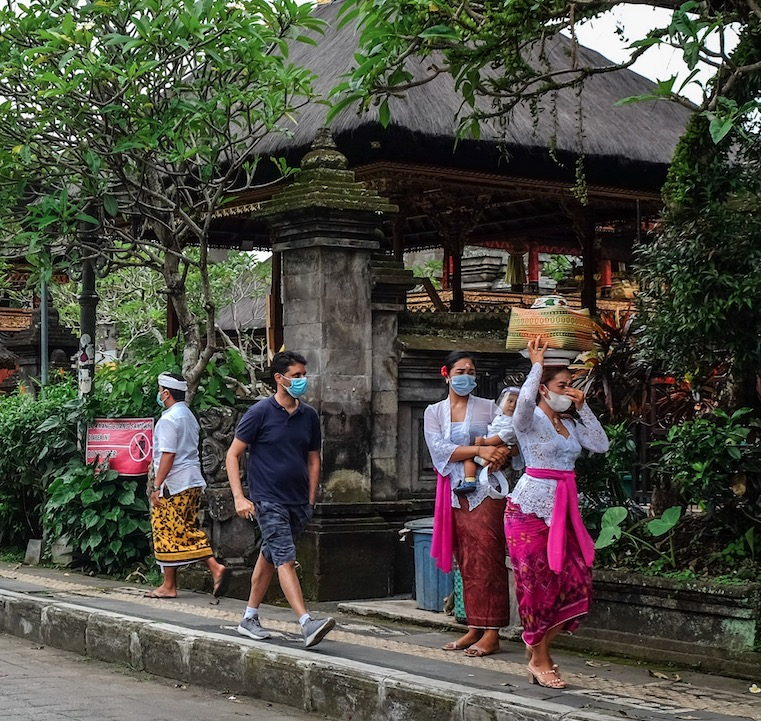 locals in masks Bali