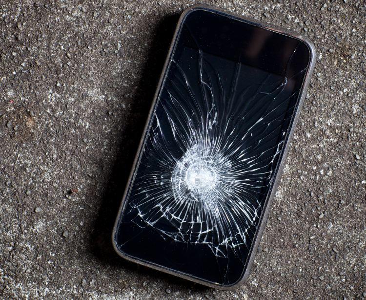 smashed phone on the ground