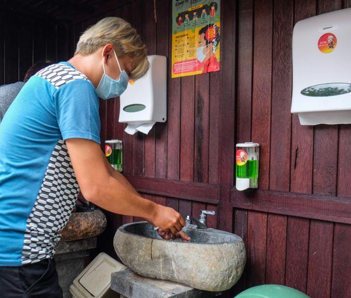 tourist at hand washing station