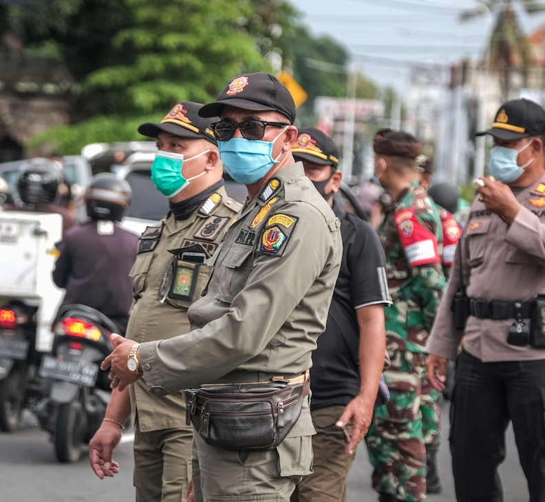 Bali police and army patrol