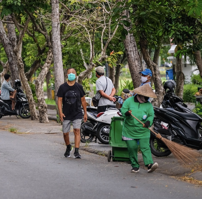 locals walking with masks