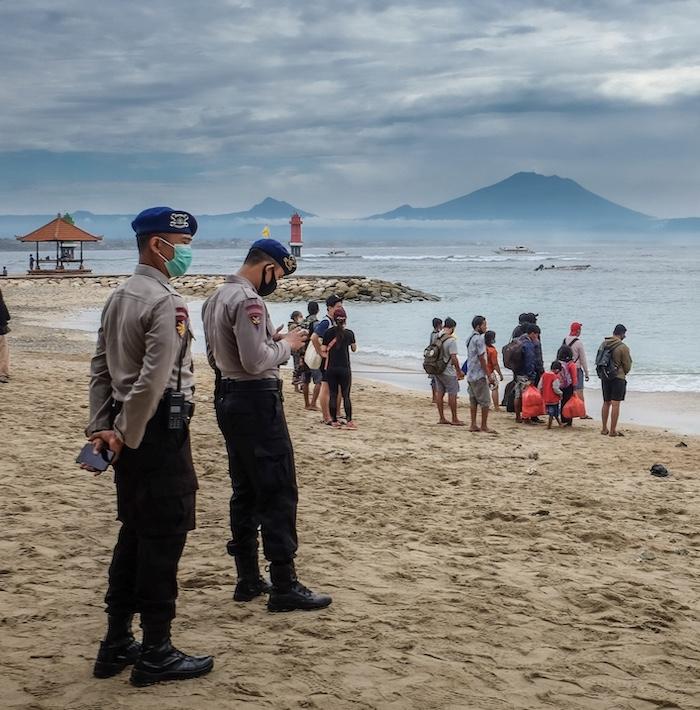 police at beach masks