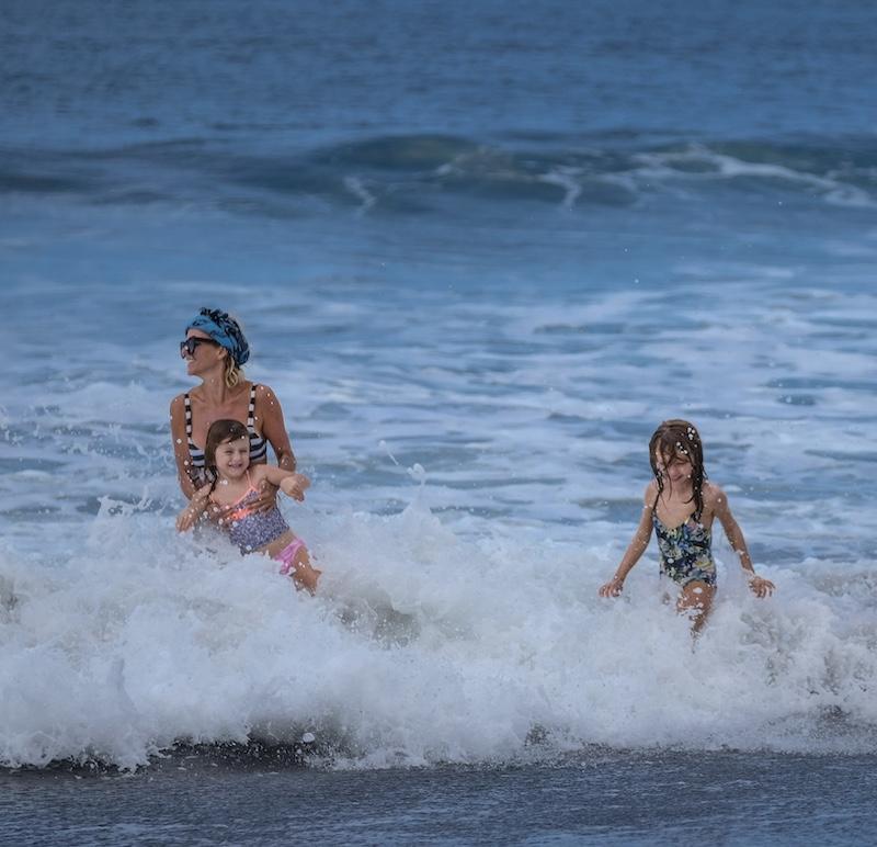 tourist family having fun at beach