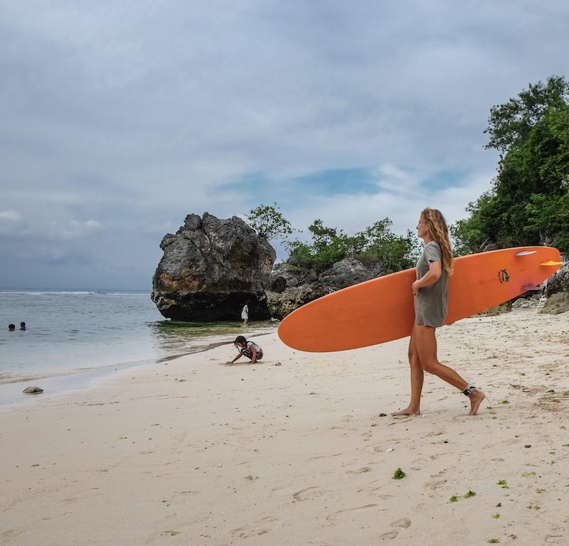 tourist surfing beach