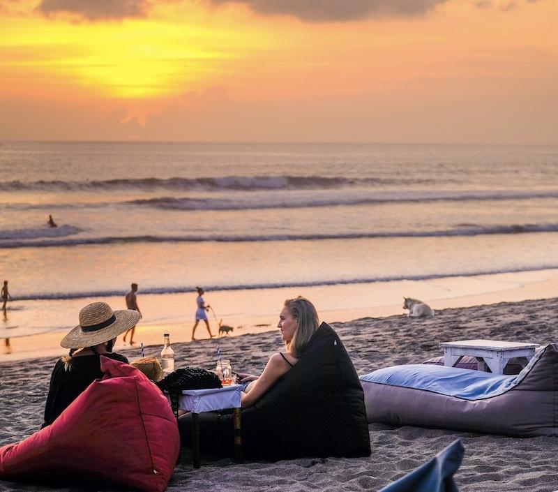 tourists sunset beach Bali