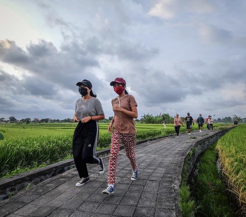 Bali locals jogging wearing face masks