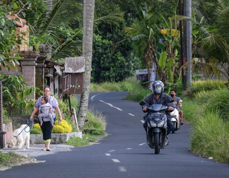 bikers facemasks and expat walking dog