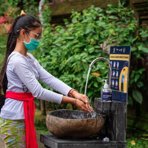 local_bali_girl_washing_hands_wearing_mask_jpg