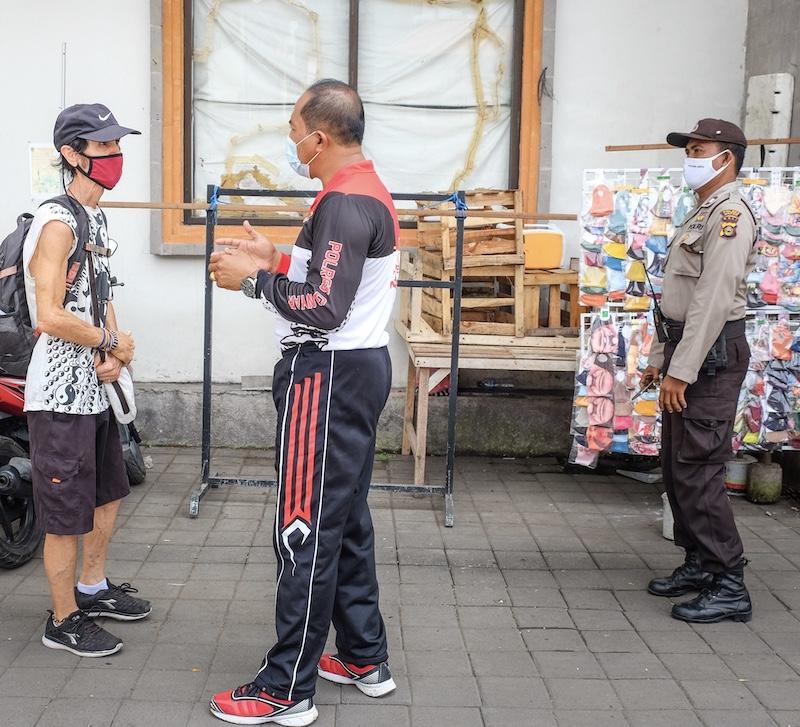 police enforcing masks rule