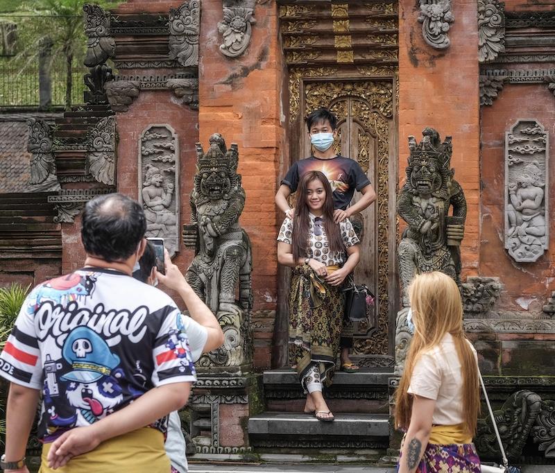 tourists masks temple