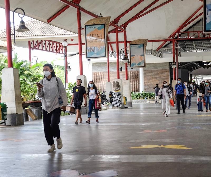 travelers at Bali airport