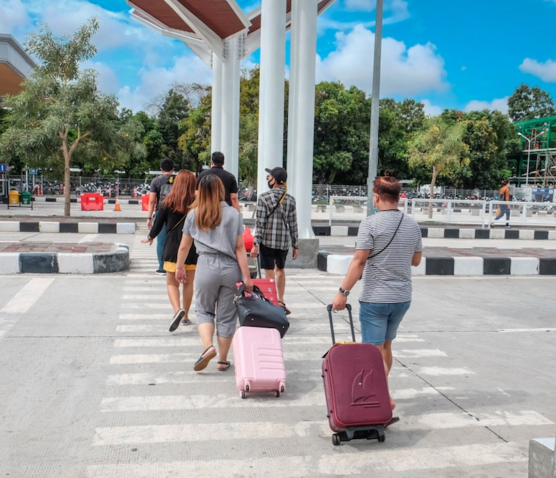 tourists arrive in Bali