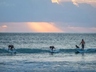 A 59-year-old man named Raymond from Australia has been rescued after losing consciousness while surfing in Bali.