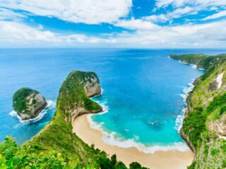 Two domestic visitors have been rescued after getting caught by large waves on Kelingking Beach, Nusa Penida.