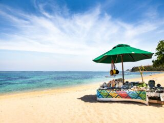 Local vendors of Kuta Beach have protested the policy that was recently implemented to permanently close 17 beach' entrances.